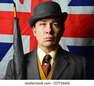 British man in blower hat with money bag