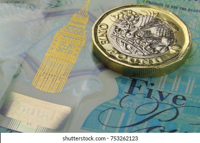 British one Pound (GBP) coin and five Pound notes close up