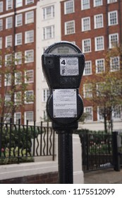 British parking meter (apartment building in Westminster, London, in the background).