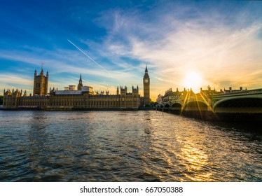 British parliament and Westminster bridge at sunset in London, UK