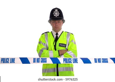 British Police officer standing behind some cordon tape. Focus is on the tape.