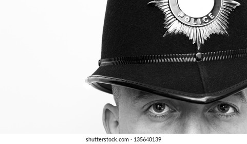 British Police Officer wearing a police helmet with copy space