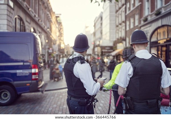 British police officers in helmets policing London streets