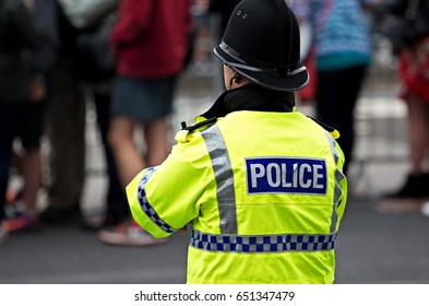 British Police Officers in high visibility uniform on crowd control