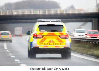 British Police Vehicle speeding down motorway