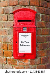 British post box with a message that reads On Your Retirement, ideal for a greeting card design