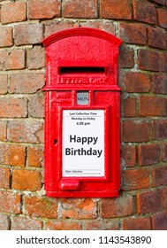 British post box with a message that reads Happy Birthday, ideal for a greeting card design