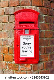 British post box with a message that reads Sorry You're Leaving, ideal for a greeting card design