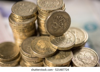 British pound Coins against a background of British assorted bank notes