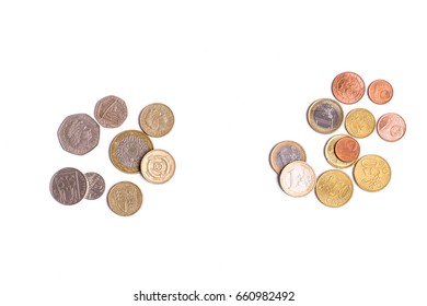 British Pound coins and Euro coins isolated on white background
