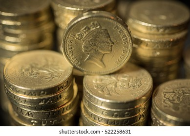 British pound coins neat stacks up close macro studio shot  Shallow Focus