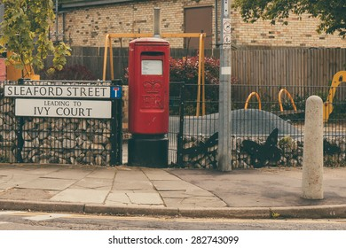 British red letter box in a street corner in Cambridge, England