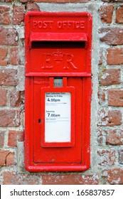 British Red Post Box set in brick wall