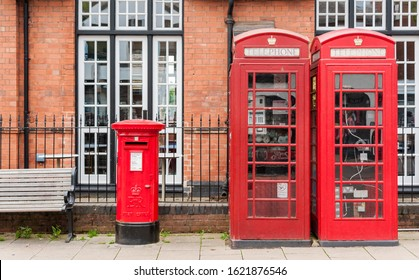 British red telephone booths beside a red post box in Stratford upon Avon, Warwickshire, England UK, the 16th-century birthplace of William Shakespeare