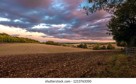 British rural landscape during sunset with blue and pinky clouds