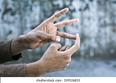 """British Sign Language (BSL) A two-handed alphabet """"S"""" used by Deaf - Mute."""