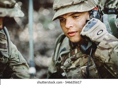 British soldier with radio tube in military maneuver. war, army, technology and people concept.