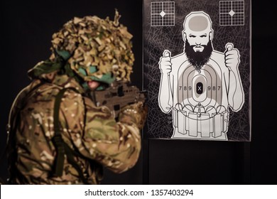 British soldier with training target. army, military and people concept. Image on a dark background.