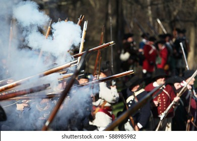 British soldiers and Militia fighting along Battle Road in Lexington, MA during the Commemorating the Patriot Day.