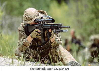 British special forces sniper with rifle take part in military maneuver. war, army, technology and people concept.