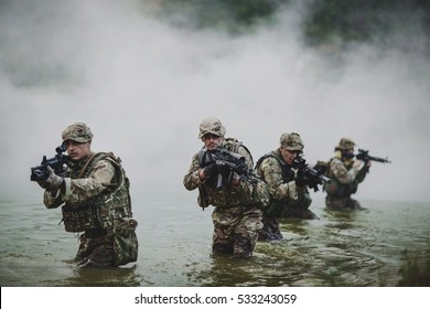 British special forces soldiers with weapon take part in military maneuver. war, army, technology and people concept.