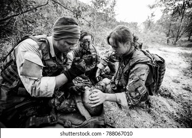 British special forces soldiers with weapons during the rescue operation. war, army, technology and people concept.