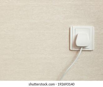 British Standard BS 1363 three pin power plug in a wall socket
