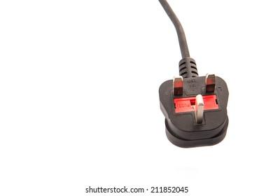 British Standard three pin AC power plugs over white background