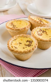 British style egg custard tarts sprinkled with nutmeg