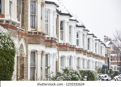 British terraced houses in winter snow around West Hampstead, London