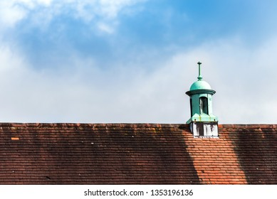 british tile roof over blue sky day view