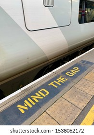 British train and 'Mind The Gap' sign painted on the platform.