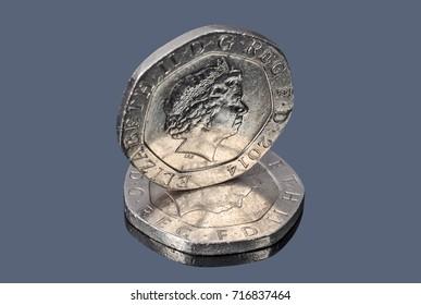 British twenty pence coins on the dark background