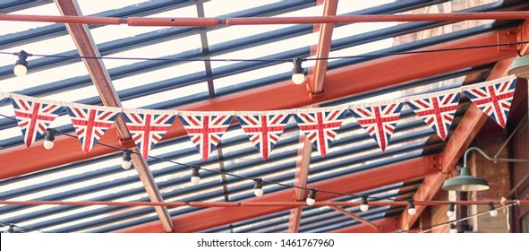 British union jack bunting , celebrating jubilee queens day. England pride, patriotic, vintage wartime english triangle bunting. Graphic flag symbolism. brexit plans.