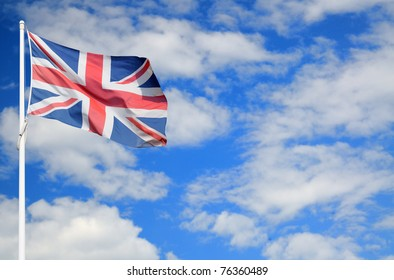 British Union Jack flag on cloudy sky with space for text