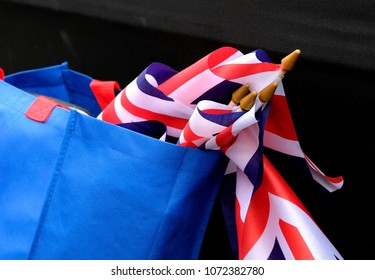 British Union Jack flags in a light blue shopping bag