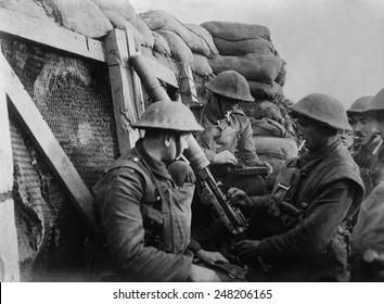 British WW1 machine gun crew in a front line trench. 1914-18.