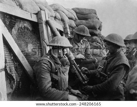British WW1 machine gun crew in a front line trench. 1914-18.