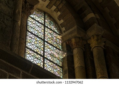 BRITTANY, FRANCE - June 13, 2018: Light Through stained glass windows reflecting and bending on cobwebs and spider webs in Mont Saint Michel in France.