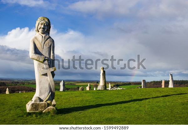 Carnoët, Brittany France March 22th 2017 : Riom / Riowen and other statues in the Valley of the Saints