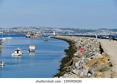 Brixham Devon England May 2019. The breakwater 500 metres long. Protects inner harbour from storms that sweep in from Torbay from English Channel. Has lighthouse at the end.