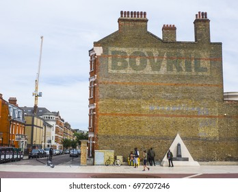 BRIXTON, LONDON- AUGUST 2017:  A residential building on Brixton, South London with  prominent Bovril sign paying homage to industrial history of the area.