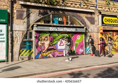 Brixton, London, UK - 15 May 2016: People walking in front of the Brixton Pound Shop. Brixton pound is London's first and currently only local currency, first issued in September 2009.