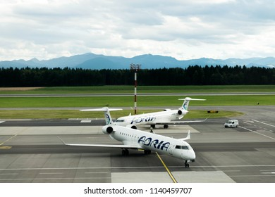Brnik, Slovenia - June 25 2018: two CRJ 900 of Adria Airways prepare for landing at Ljubljana Airport, Slovenia