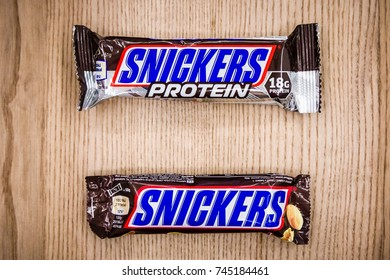 BRNO - AUGUST 23: Comparison of classic Snickers and protein Snickers bars on August 23, 2017 in Brno, Czechia.