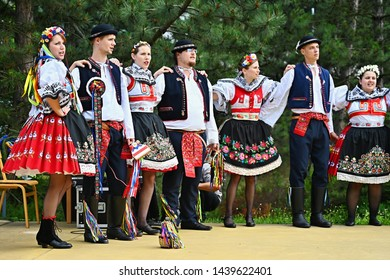 Brno - Bystrc, Czech Republic, June 22, 2019. Traditional Czech feast. Folk Festival. Girls and boys dancing in beautiful costumes. An old Christian holiday, a day of abundance, joy and prosperity.