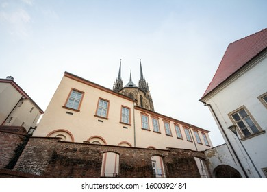 Brno Cathedral of saints peter and paul, seen from the bottow of Petro Hill, at dusk. Also called katedrala svateho petra a pavla, it is a major landmark of the city of Brno, Moravia, Czech Republic.  - Shutterstock ID 1600392484