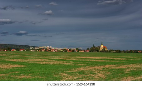 Brno city landscape view from Troubsko village. In the foreground the village church of Troubsko. In the background Brno with the block of flats. - Shutterstock ID 1524164138