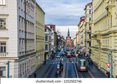 Brno / Czech - Dec 2015: The street with tram in Brno downtown full of people at Christmas time. Winter in Eastern Europe.