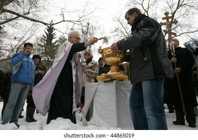 BRNO, CZECH REP - JANUARY 19: Orthodox Christians celebrate Epiphany by the river Svratka on January 19, 2010 in Brno, Czech Rep.